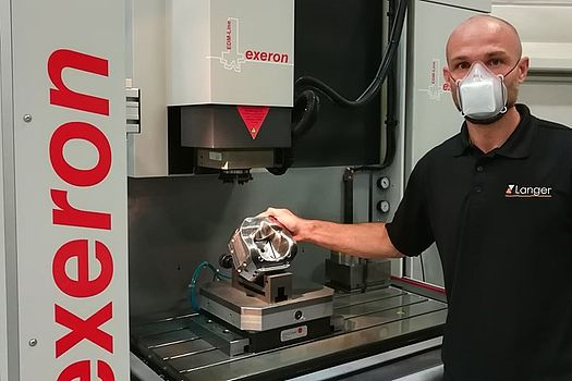 Robert Kühn shows the finished mold cavity on an Exeron die-sinking EDM machine.